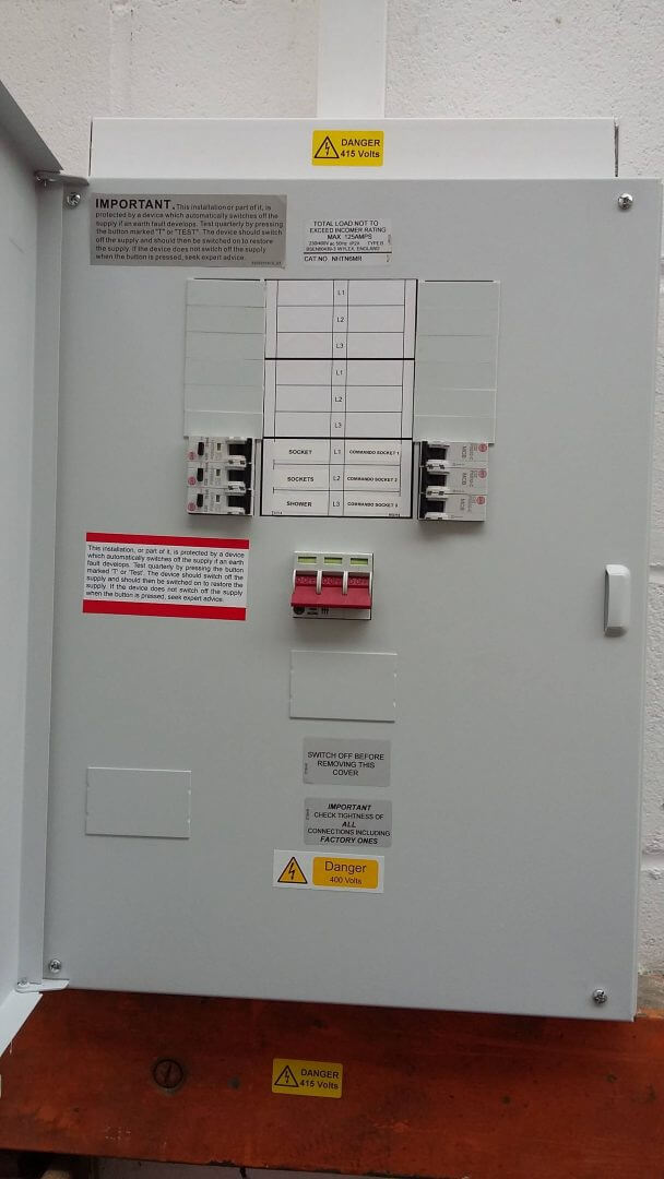 contractors replace electrical fuse box in a Essex school