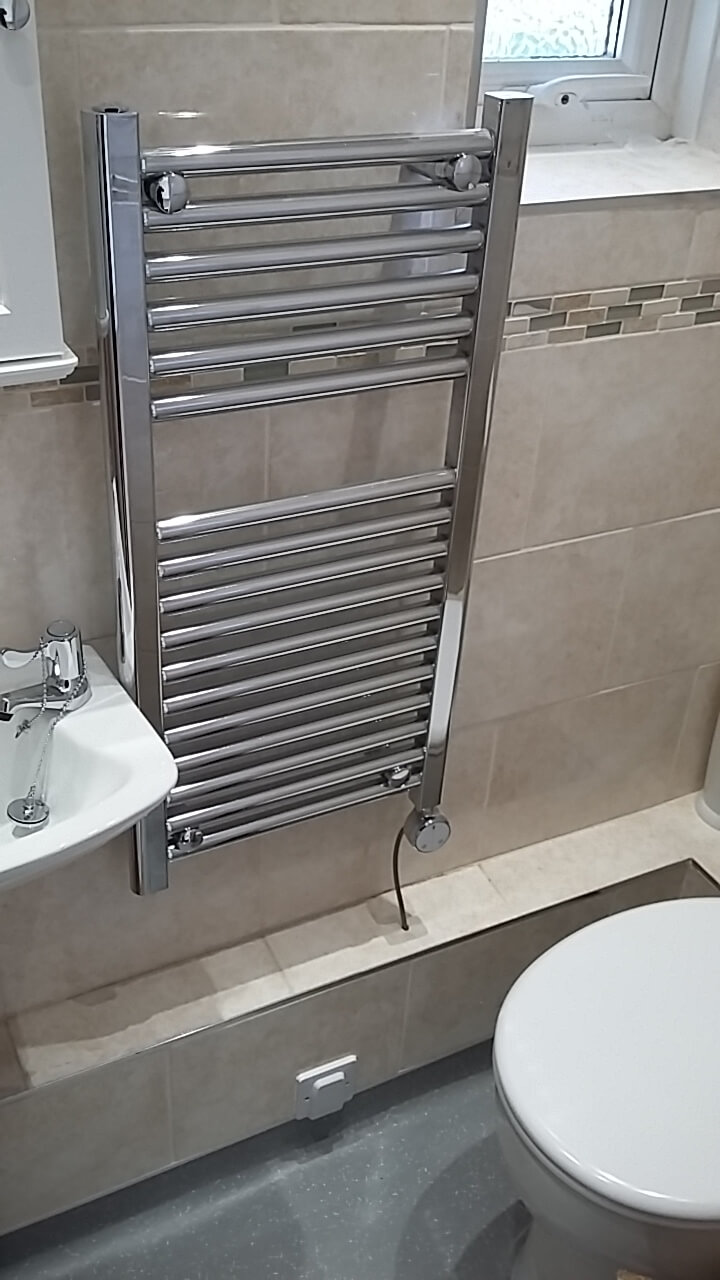 Essex contractor installs heated towel rail to bathroon